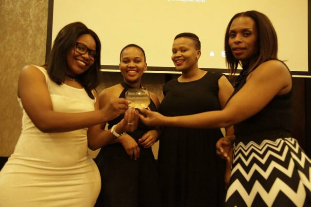 Multichoice Marketing team scoops the two coveted awards presented by Mamosa Makaya (right).
