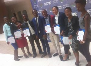 Equity Investments Director, Mr. Zwelithini Matsoso posing with some of the 29 awarded volunteers